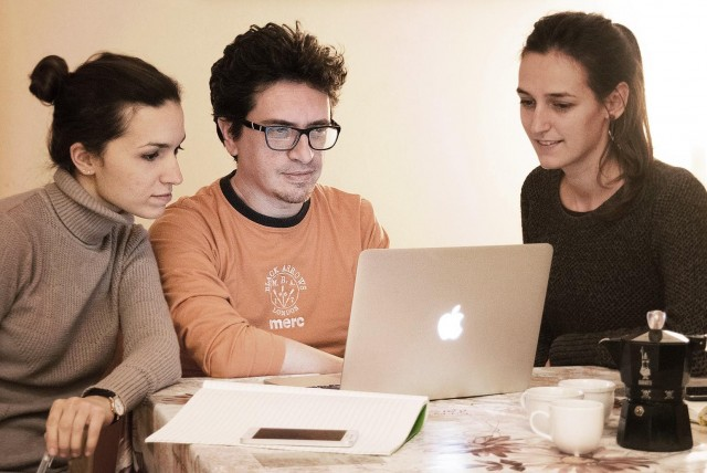 Martina Manara (left) working on the HIHere App with colleagues