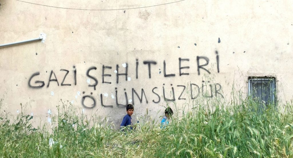 Janetta Deppa's photo, 'Sehitler Ölümsüzdür' (translated: The Immortal Martyrs) of our Generation: Migrants Living on the Margin